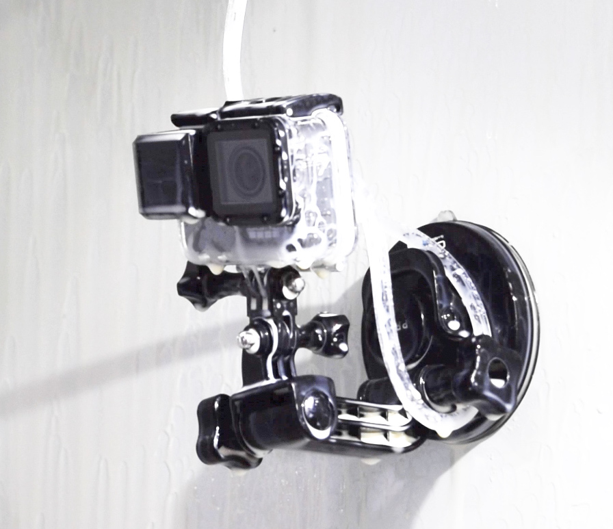 GoPro camera inside a CNC machine with air knife attached. The lens is clean.